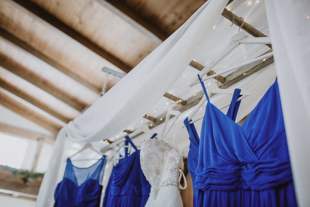 Manitoba bride painted names of bridesmaids on hangers for their gowns.
