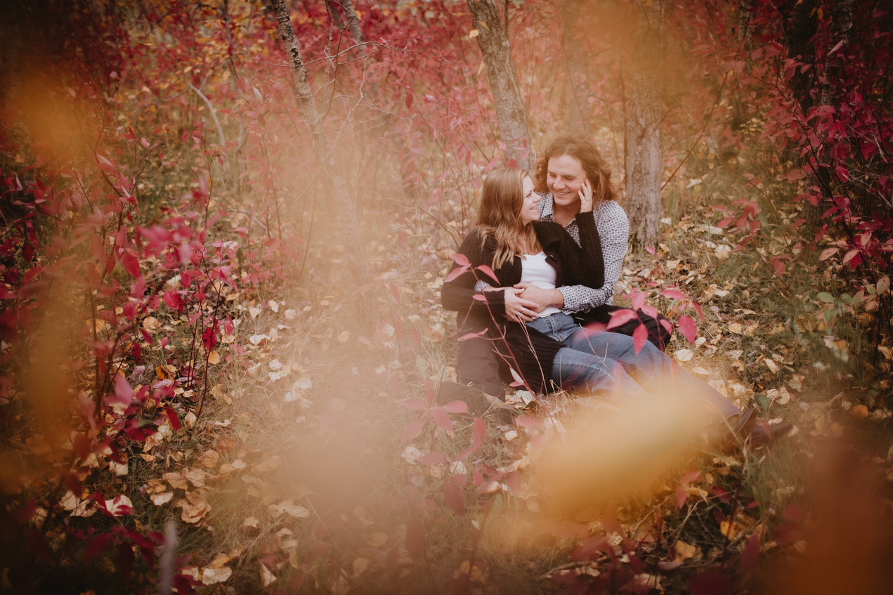 Couple Cuddles in Fall Foliage