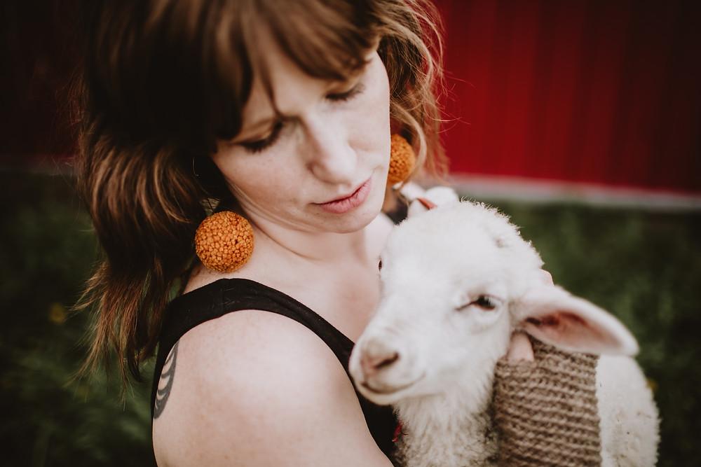 Pumpkin coloured wool, pom earrings.