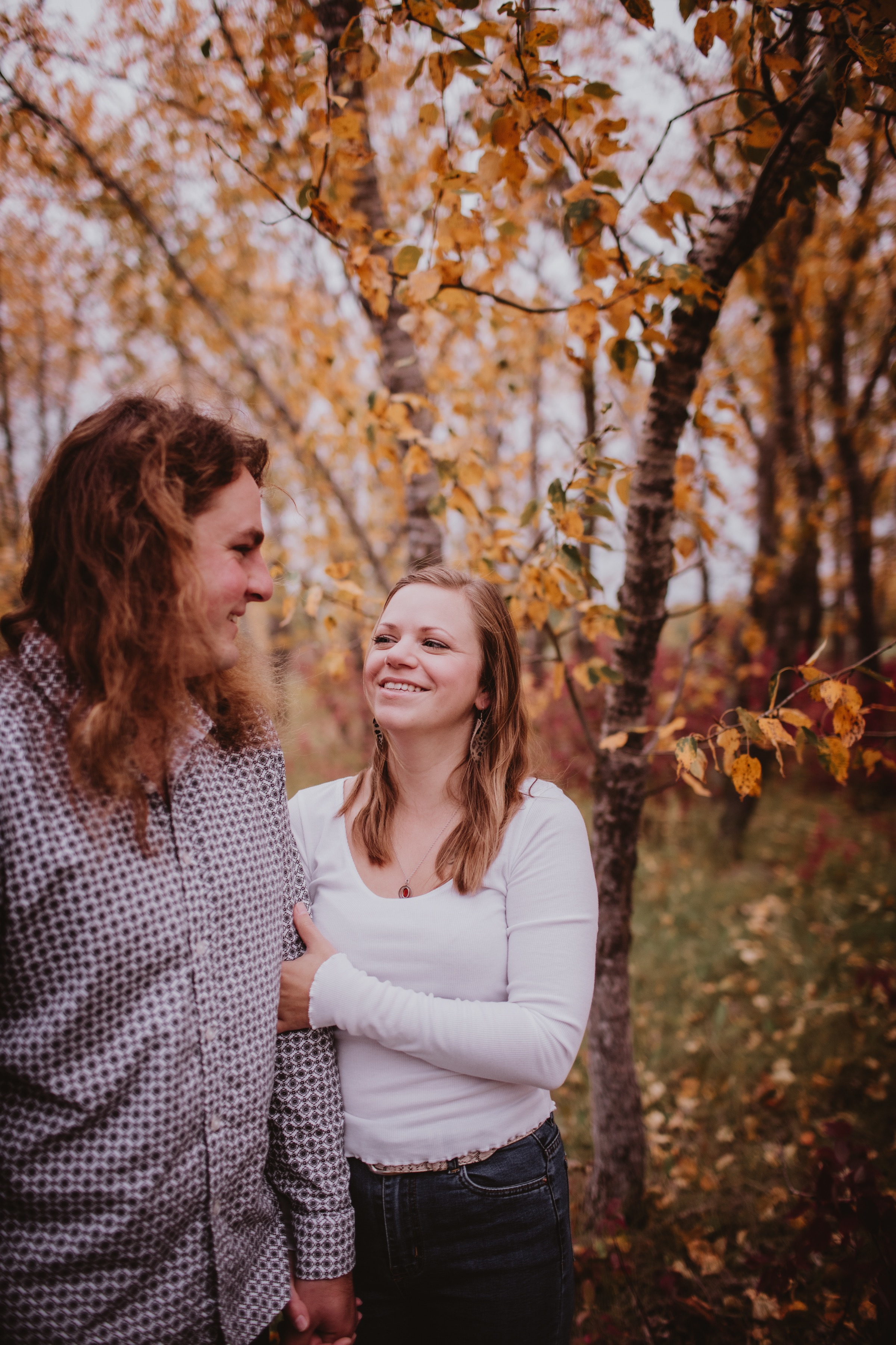 Fall Photo Session in Rural MB - couple chooses their property in rural Manitoba as their engagement session photo session.
