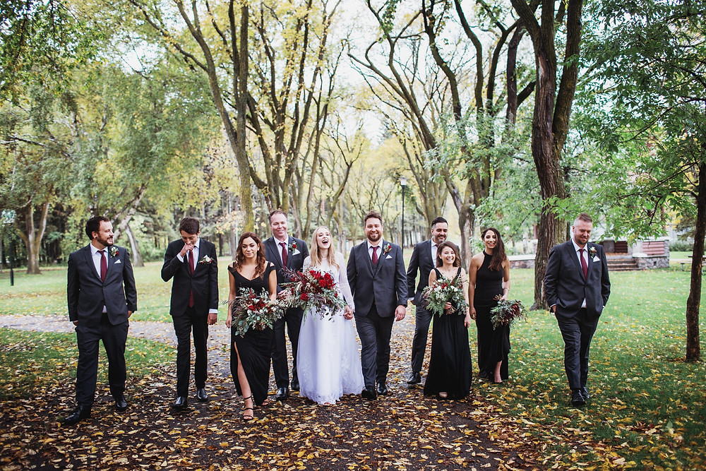 Casual wedding party photo. Fall wedding in Clear Lake, Manitoba.
