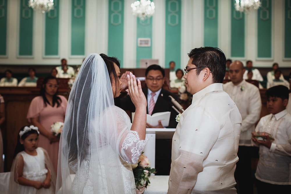 Bride and groom share their wedding vows in church wedding ceremony.