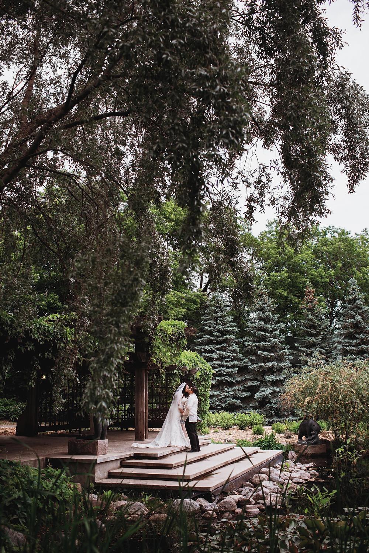 Winnipeg wedding day portraits in Leo Mol Sculpture Garden.