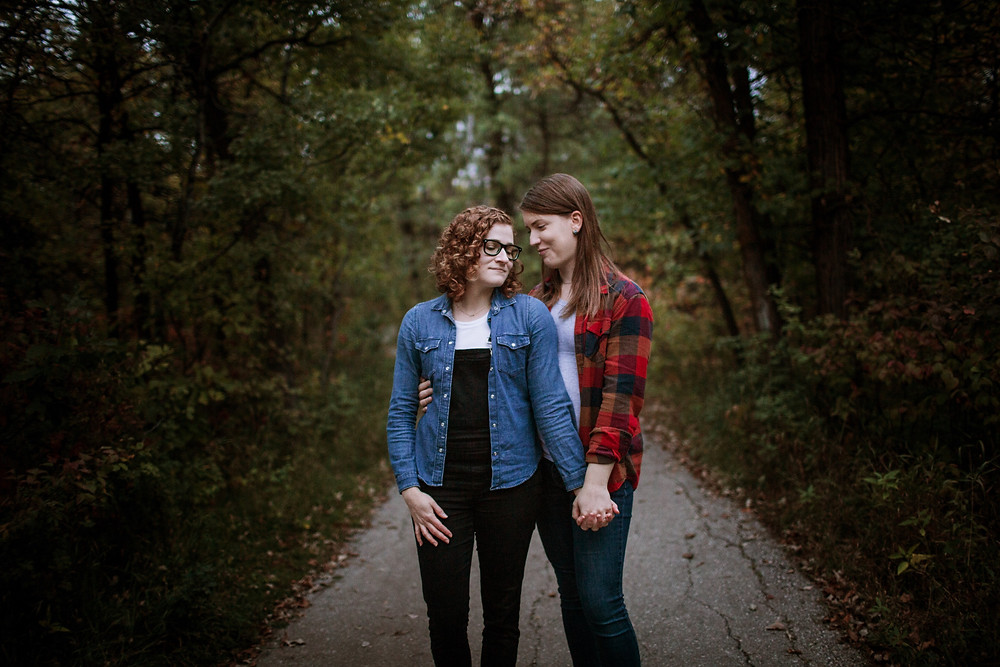 Couple poses in forest.