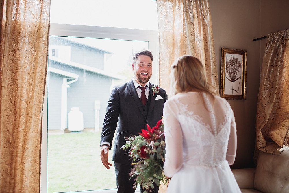 Groom sees bride for the first time on their wedding day in Clear Lake, Manitoba.