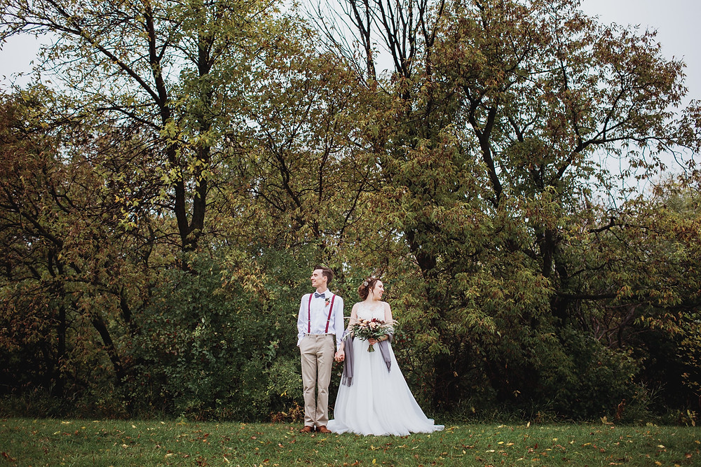 Couple during their rainy fall wedding in Southern Manitoba