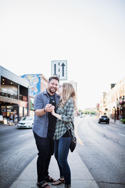 Couple poses on Osborne Street median.