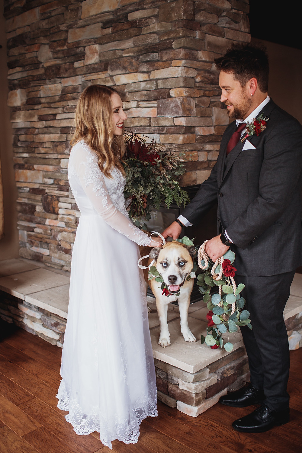 "Bride, groom and ""flower"" dog wait to celebrate their nuptials in Clear Lake, Manitoba."