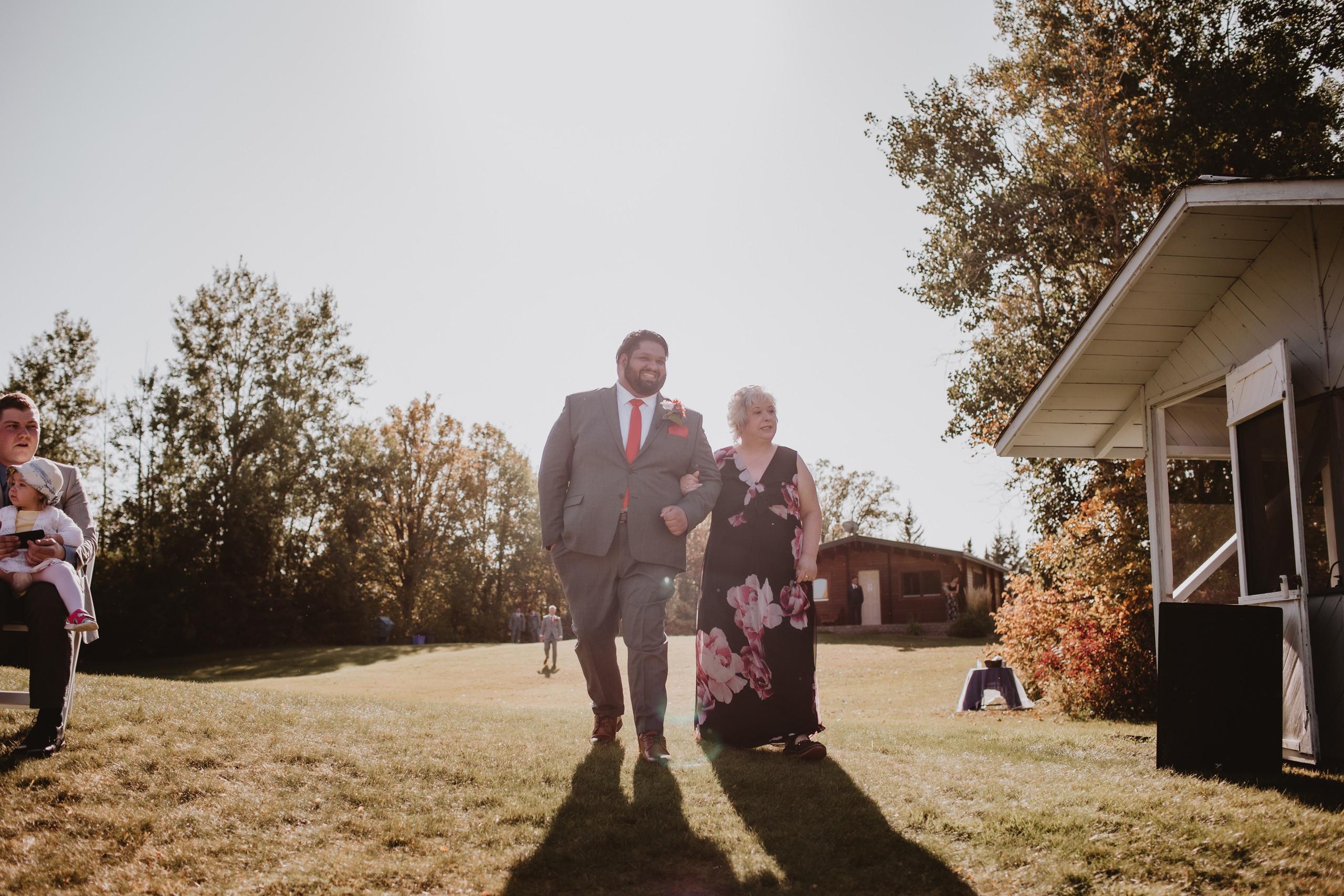 Mom Walks Groom Down Aisle during fall wedding in Elma, Manitoba.