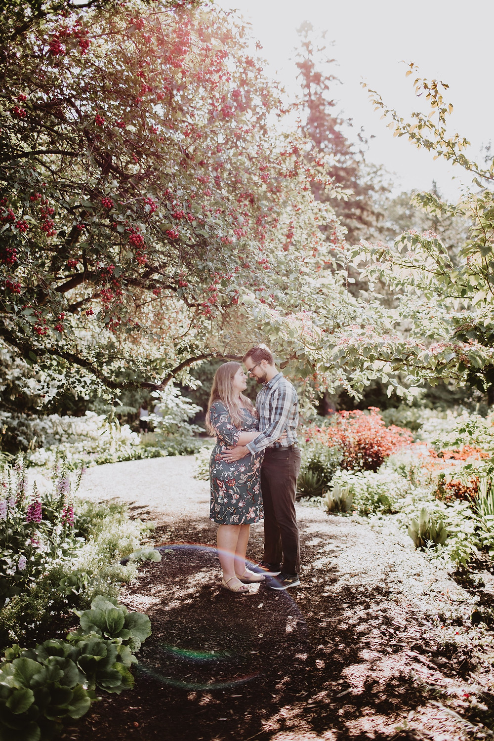Stunning morning maternity photo session in the English Gardens in Winnipeg, Manitoba.