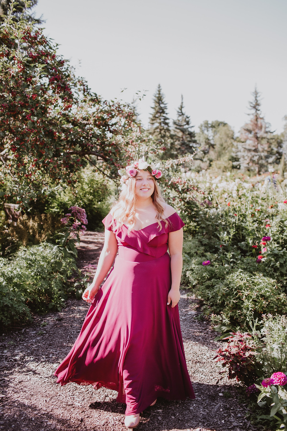 Stunning cranberry, off-the-shoulder, floor length graduation gown.