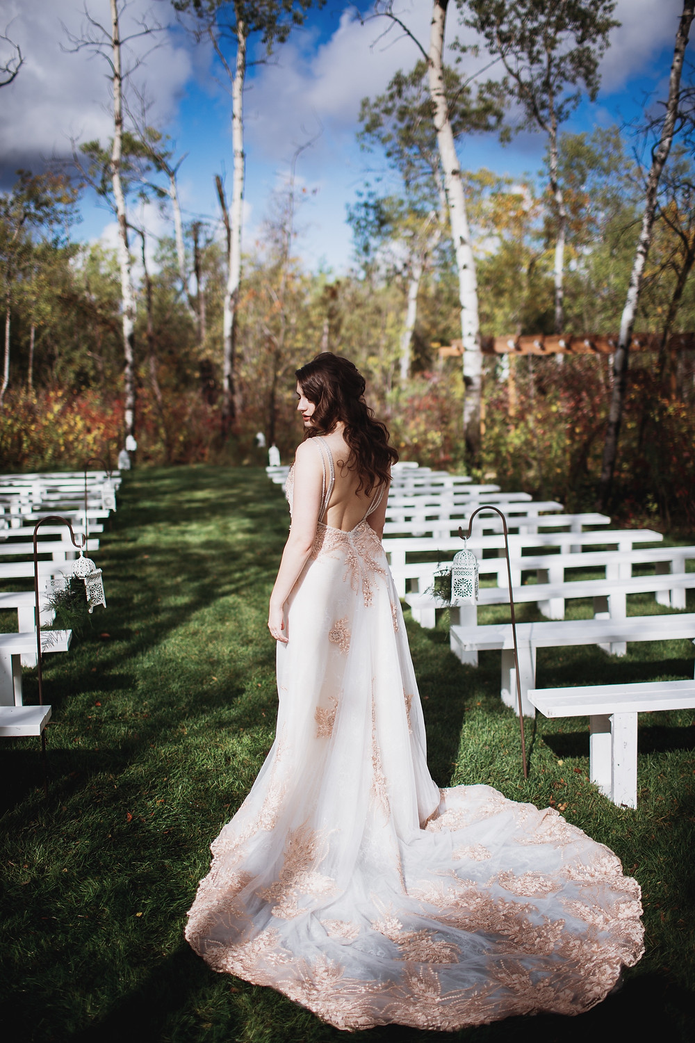 Bride poses in Kinloch Grove's outdoor ceremony space.