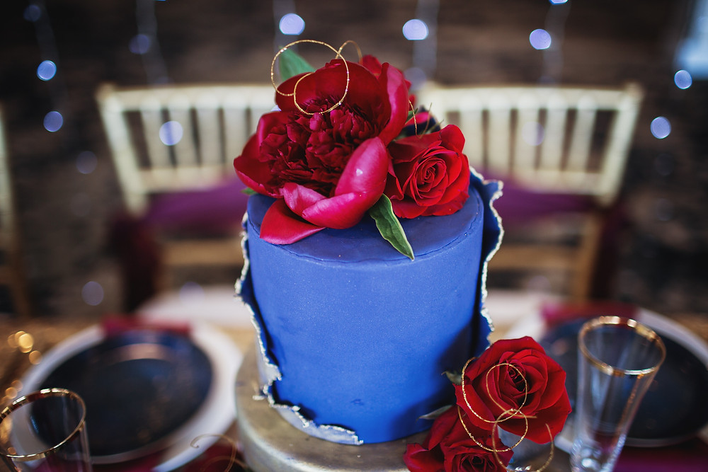 Marvel's Avenger-themed wedding cake in blue and gold.