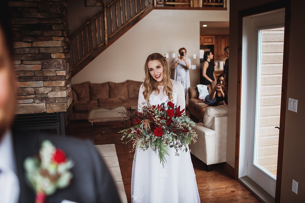 Bride waits to see the groom for the first time on their wedding day in Clear Lake, Manitoba.