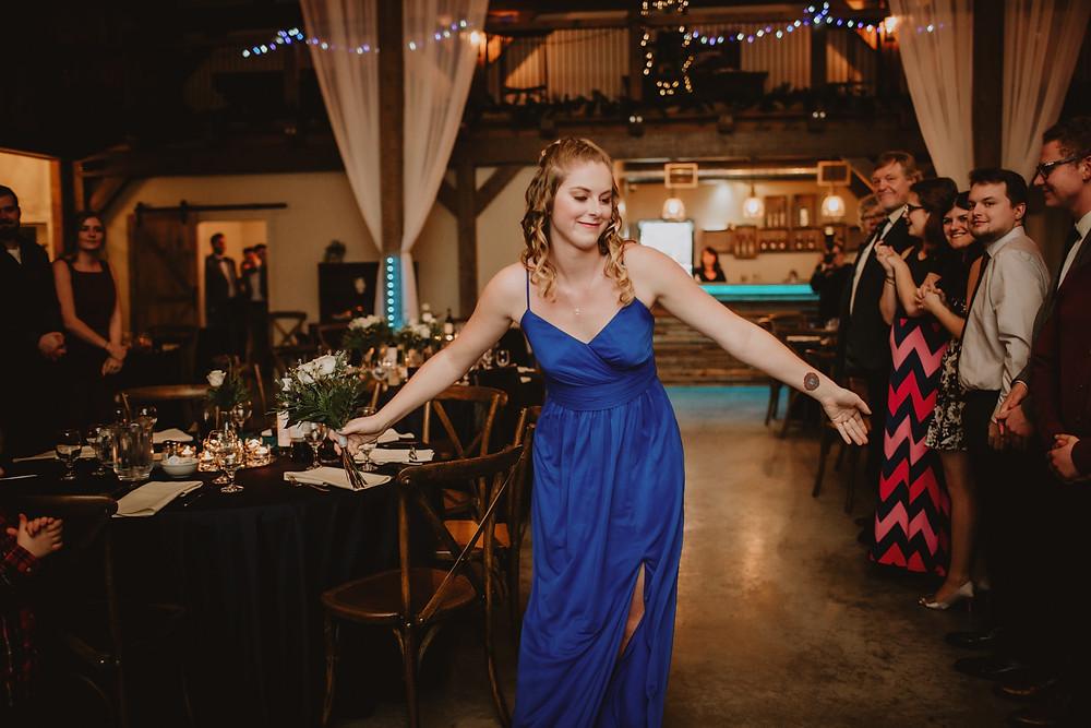 Bridesmaid enters wedding reception at Hawthorne Estates.