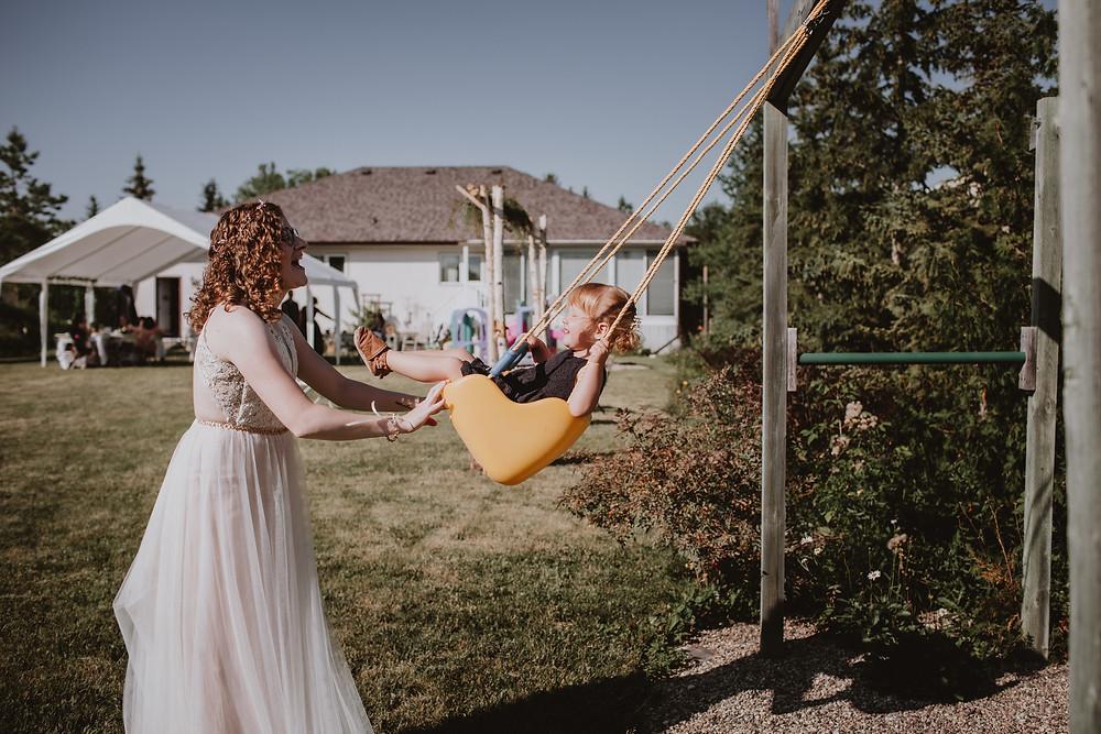 Bride swings flower girl.