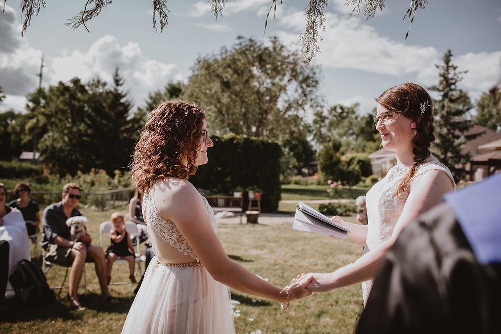 Brides exchange vow during micro-wedding in Winnipeg, Manitoba.