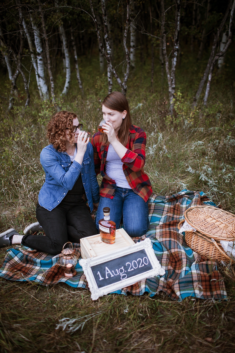 Future brides enjoy their favourite drink during their engagement session.