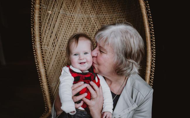Grandma Kisses Baby Girl on Cheek
