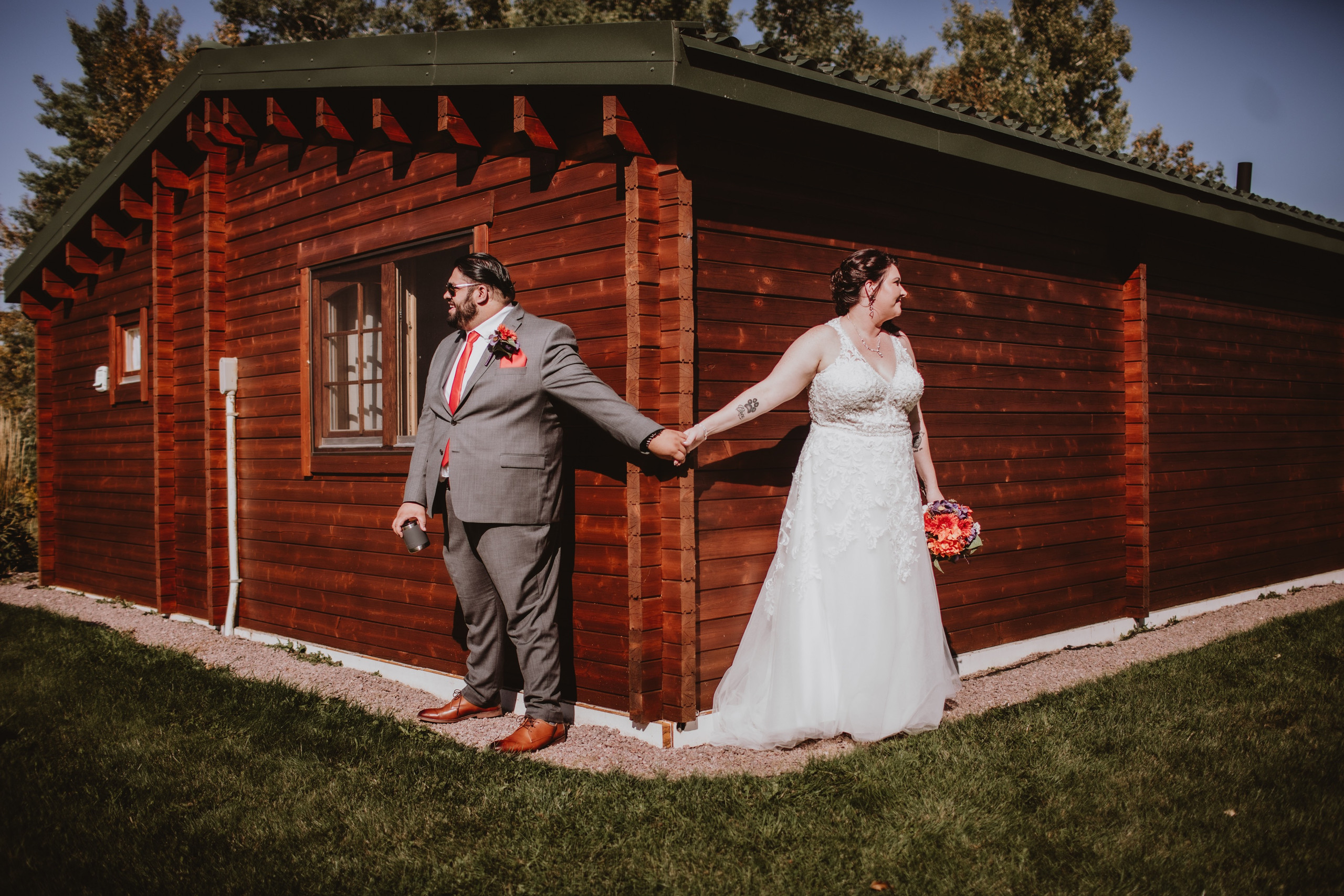 Manitoba Wedding Couple didn't see each other before the ceremony, but held hands around a corner.