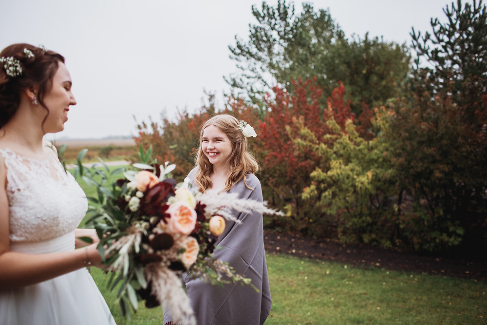 Fall bride with her bridesmaid.