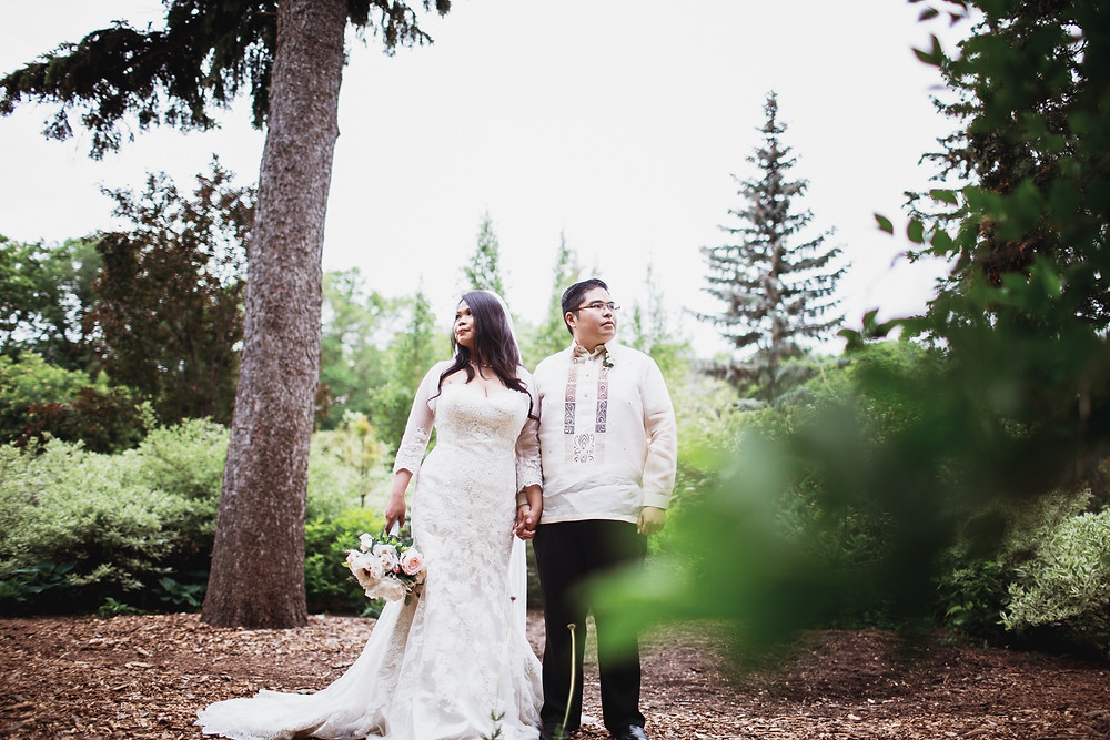 Bride and groom during their wedding day portraits in Assiniboine Park, Winnipeg, Manitoba.