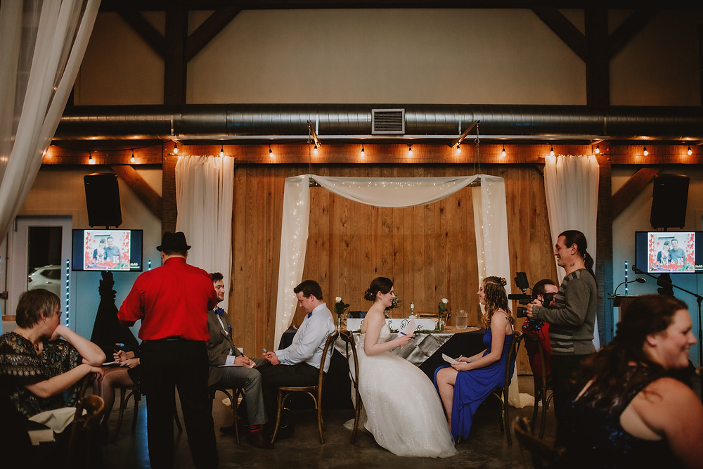 Gopher the Music leads newlywed game during wedding reception at Hawthorne Estates