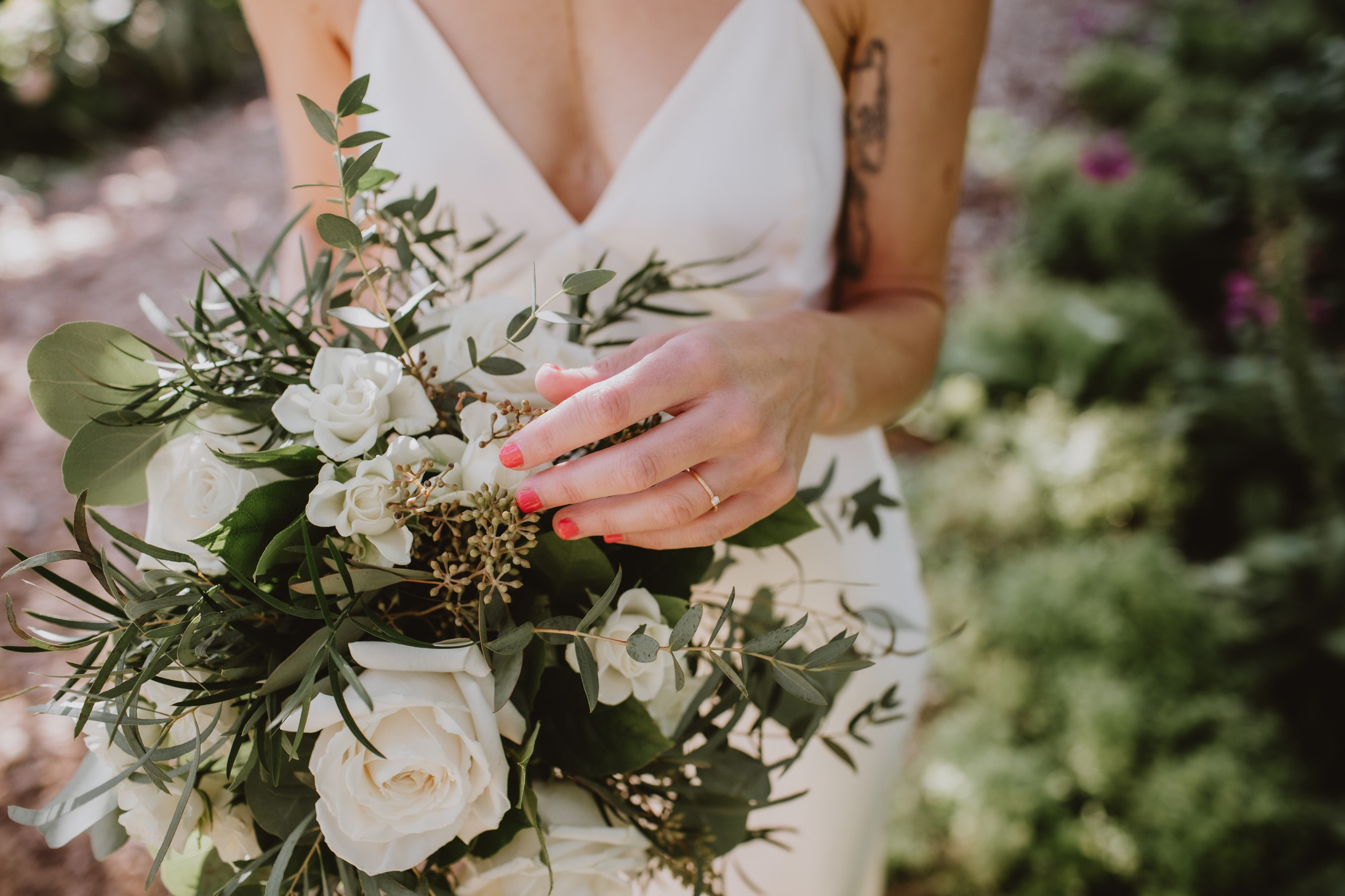 Minimalist Bouquet Inspo with white floral and a variety of greens.