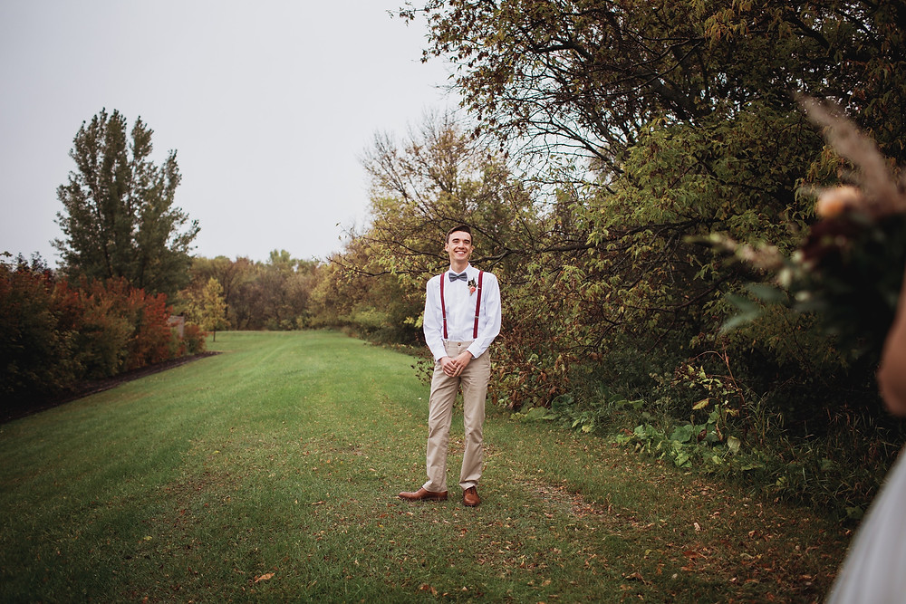 Groom see bride for the first time on their fall wedding day.
