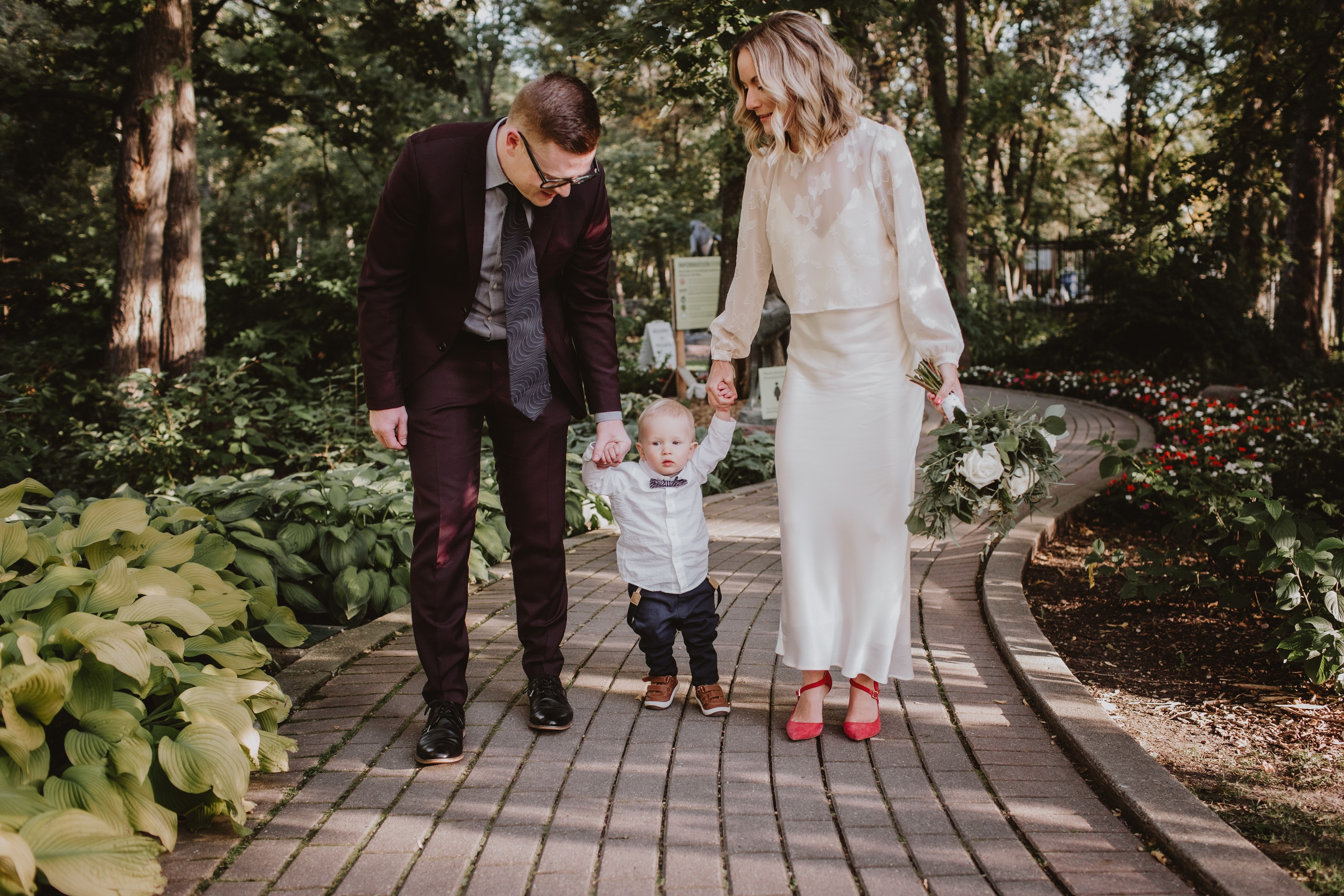 Wedding Couple Walks With Son after micro wedding ceremony.