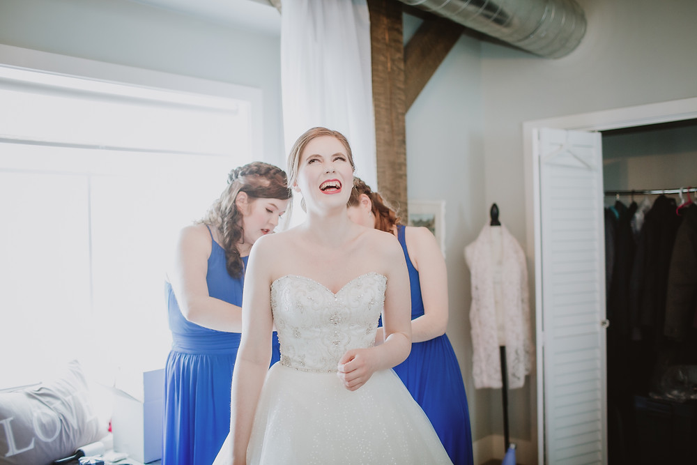 Bride getting ready with help from her bridesmaids.