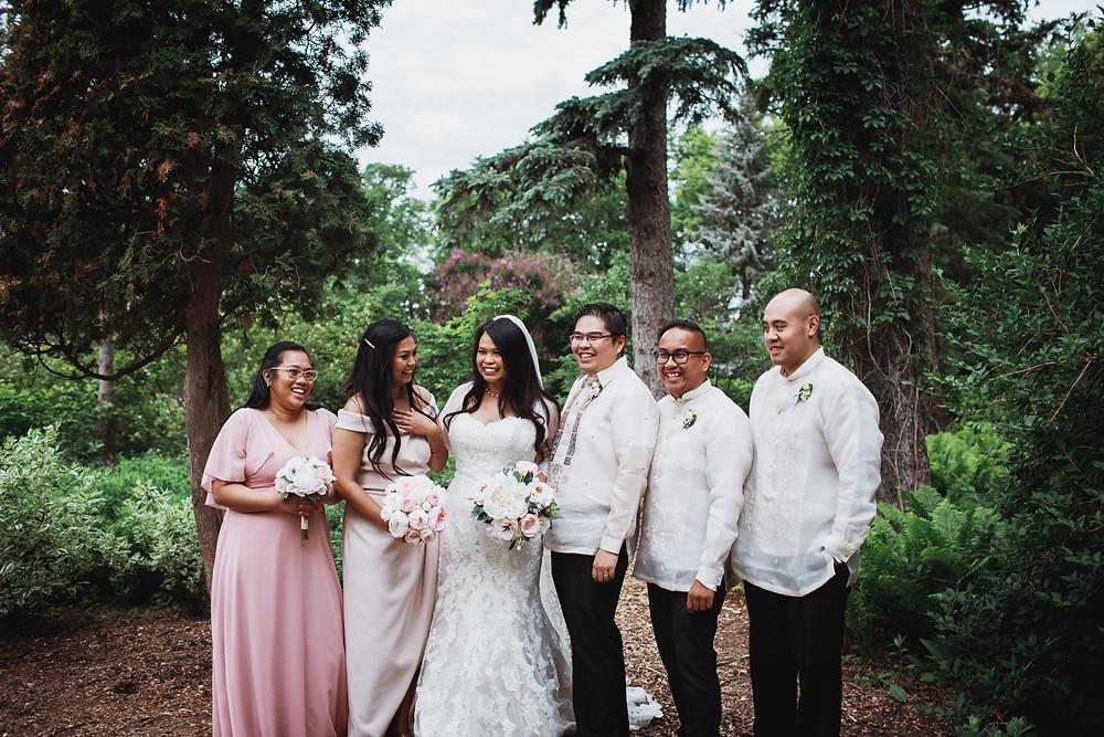Light pink bridesmaid dresses and off-white barongs, Filipino bridal party in Winnipeg, Manitoba.