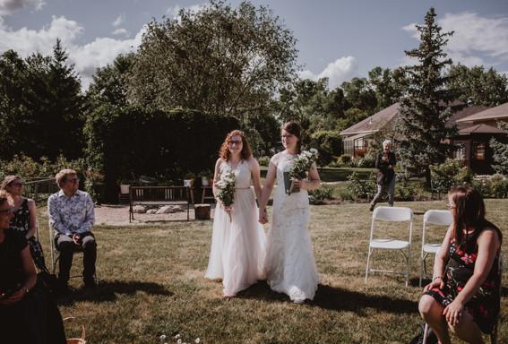 Brides Walk Down Aisle