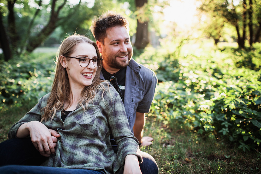 Couple relaxes in Munson Park during engagement photo session.