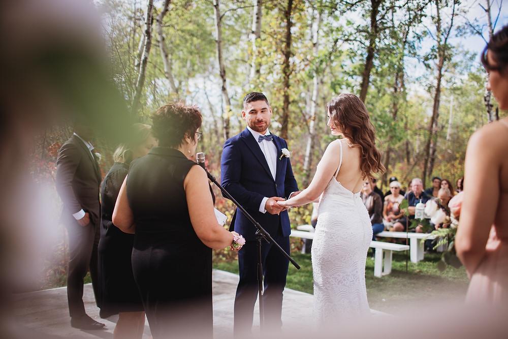 Fall outdoor wedding ceremony in  Matlock, Manitoba.