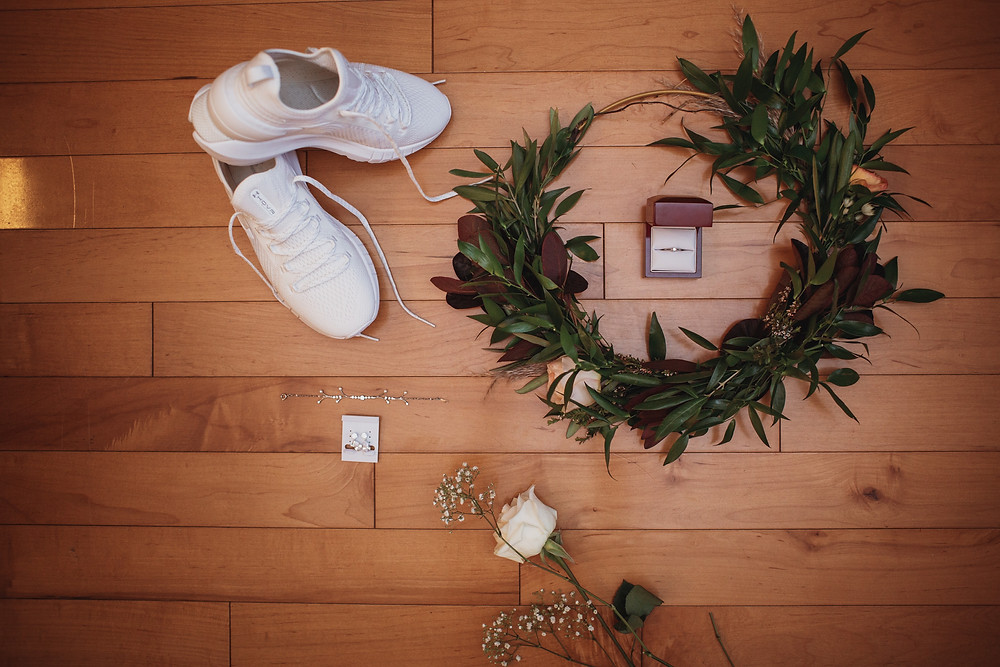 Flatlay of bridal details from Kaitlyn's fall wedding in southern Manitoba.