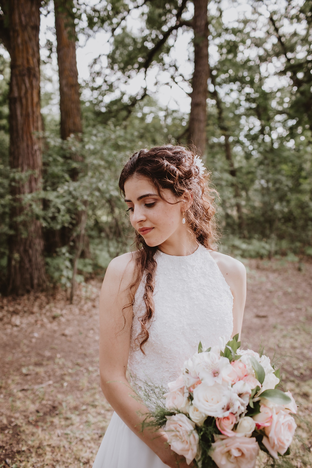 Stunning bride poses in forest.