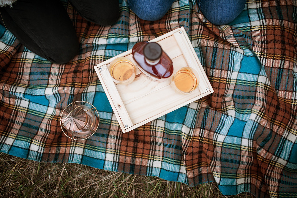 Blue and brown picnic blanket.