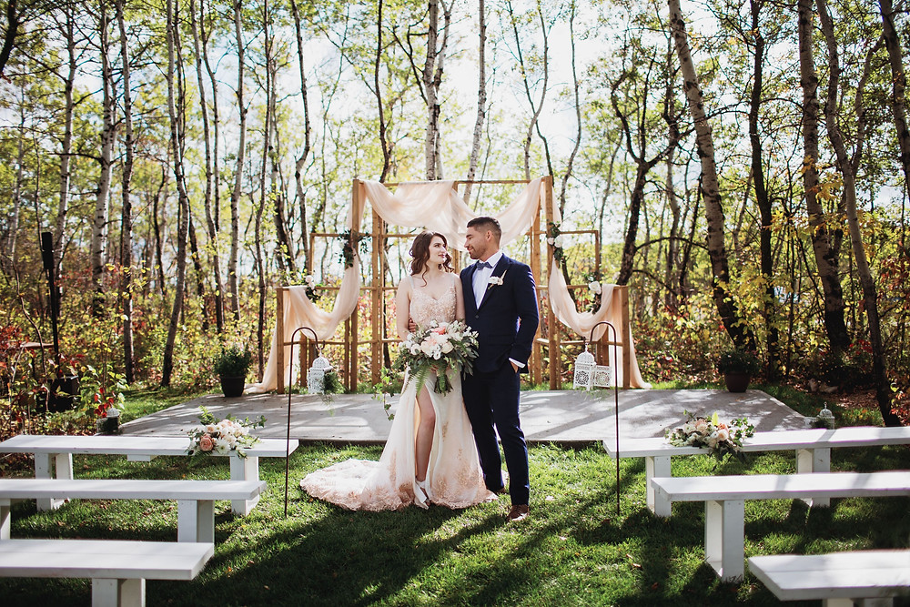 Blush wedding gown with navy groom's suit and blush wedding decor