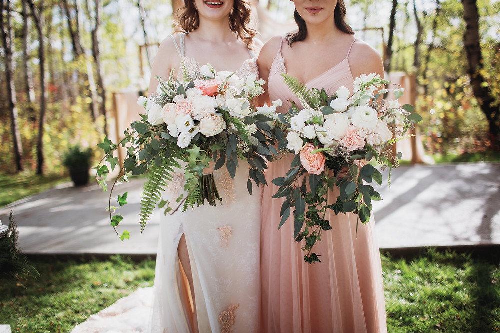 Bridal bouquets by Yellow Birch Floral, blush and white with hearty greens.