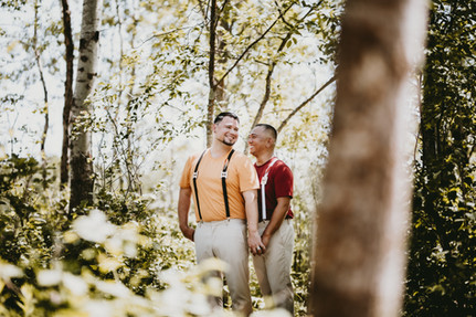 Smiling Grooms Pose for Wedding Portraits