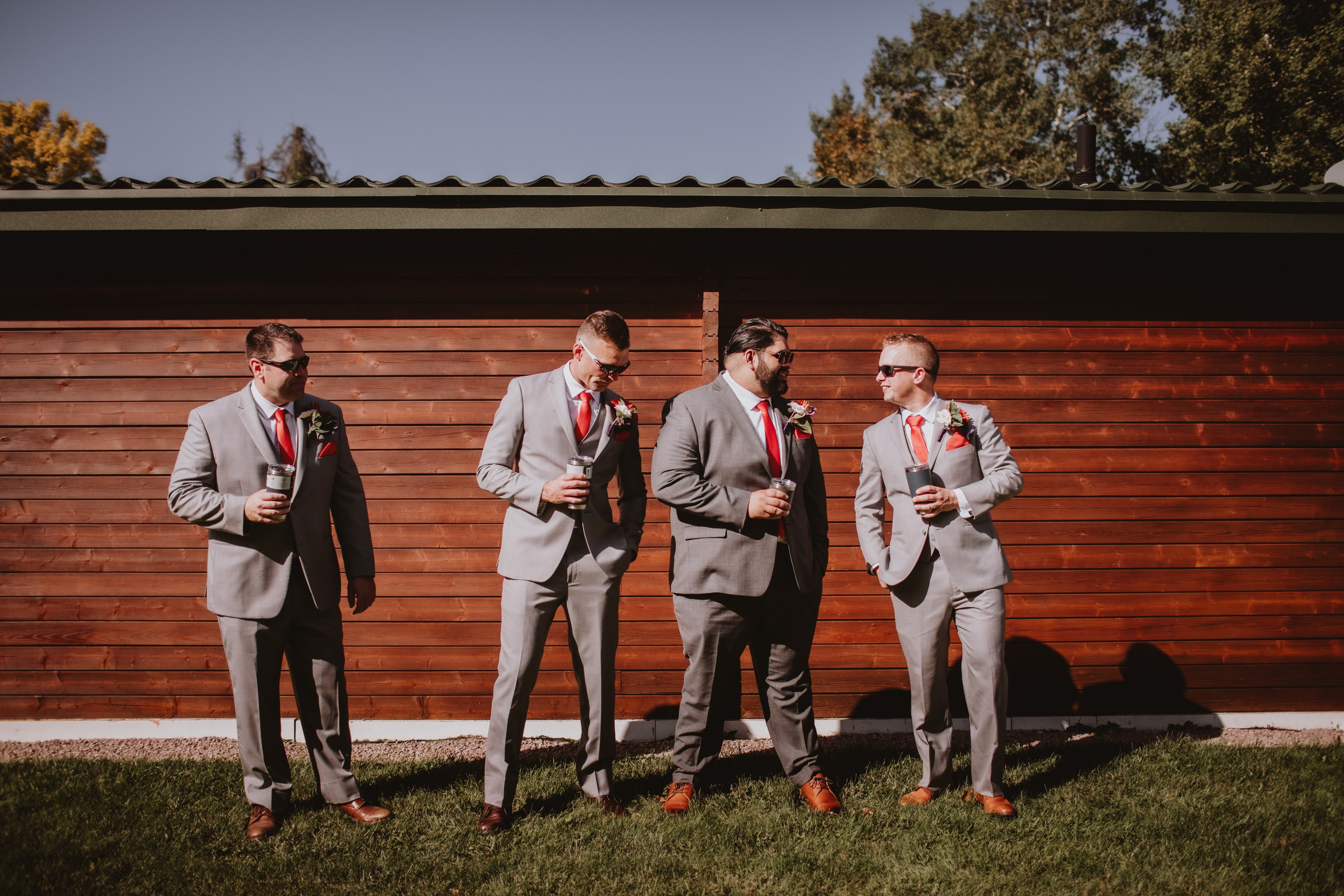 Groom and Groomsmen share a drink.