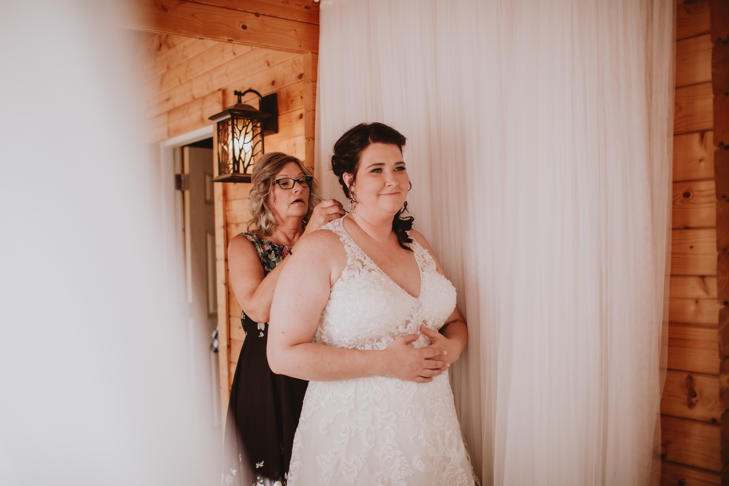 Mom Closes Bride's Dress during fall wedding in Canada.