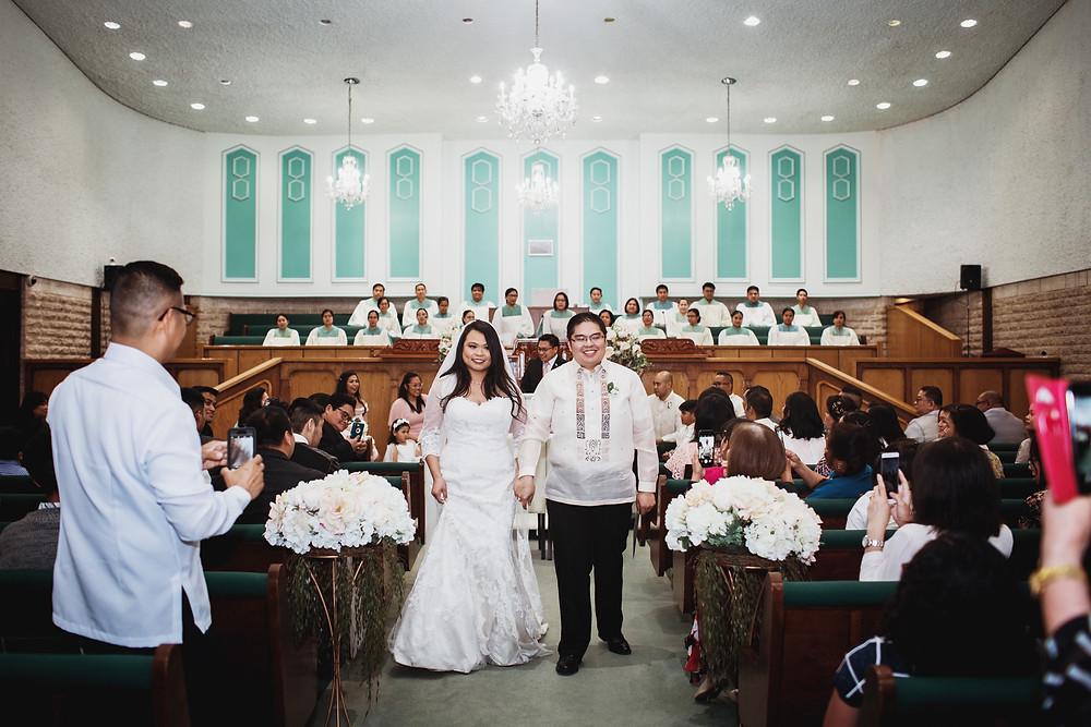 Winnipeg church wedding, bride and groom exit.