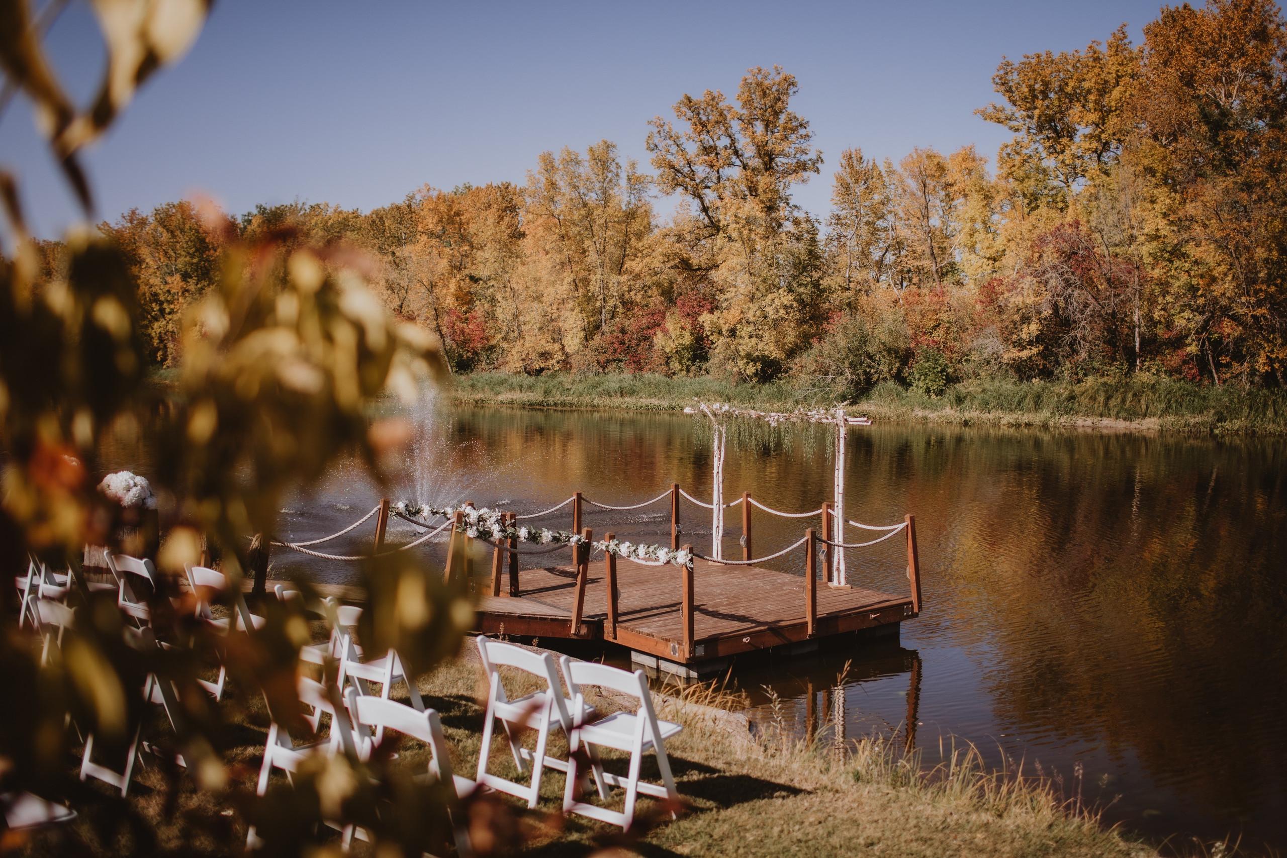 Fall Riverside Wedding ceremony on dock.