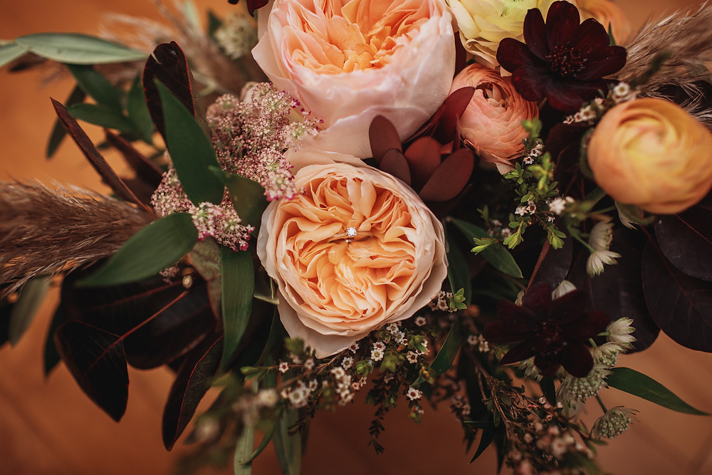 Fall bridal bouquet with engagement ring. Bouquet by Earth Buds Florist.