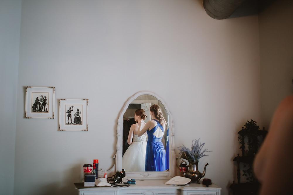 Bride getiting dresses in Hawthorn Estate's bridal suite.