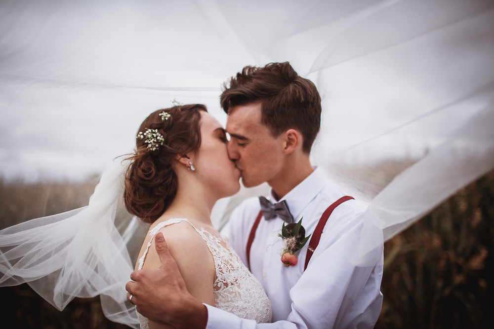 Newly weds kiss in Winkler, Manitoba.