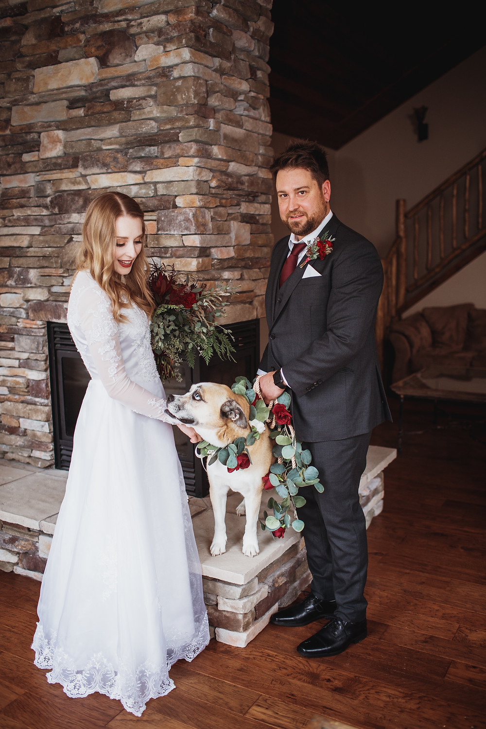 Bride and groom pose with their dog on their wedding day in Clear Lake, Manitoba.