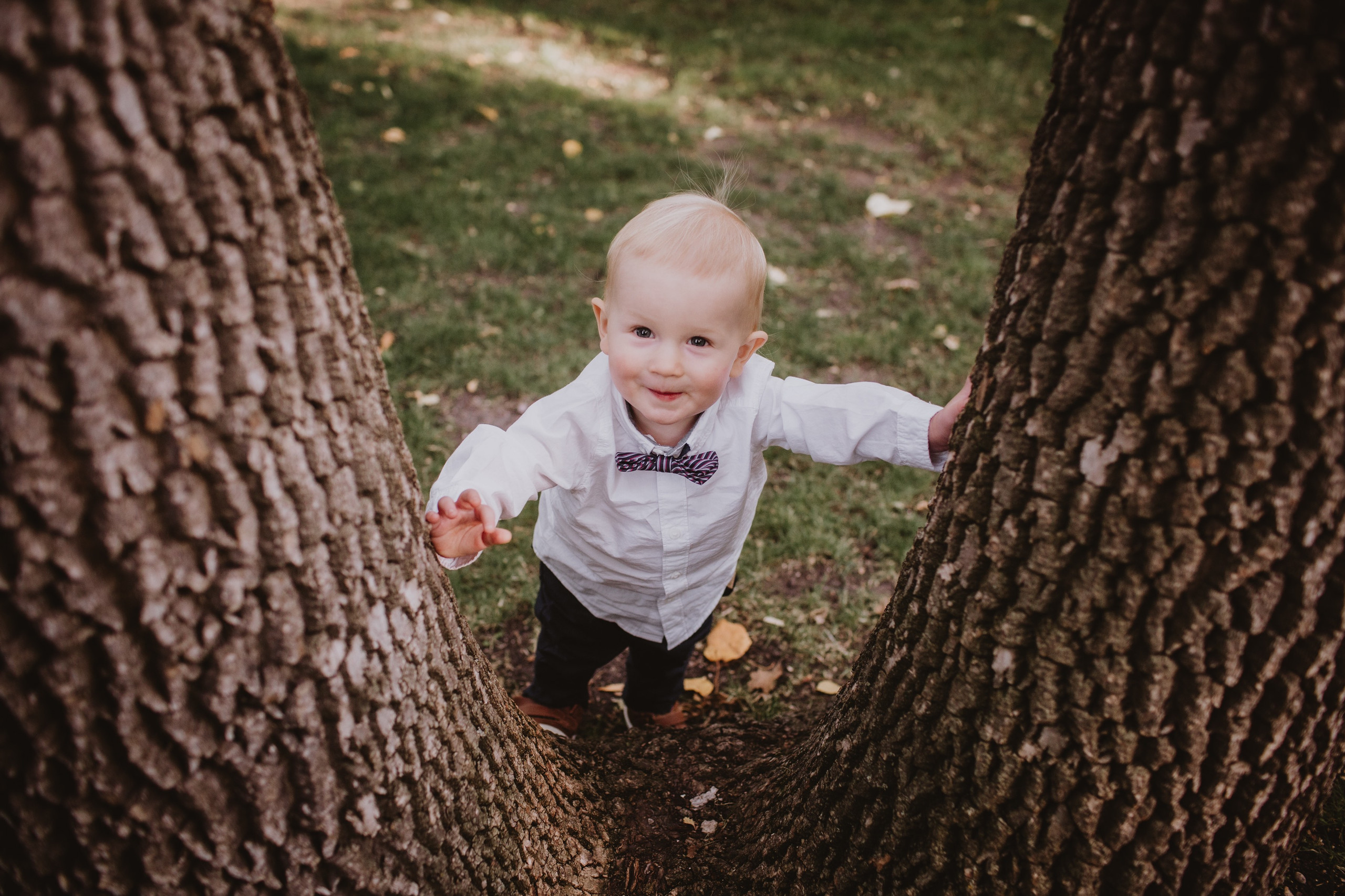 Cute Ringbearer Plays in Park after wedding ceremony.